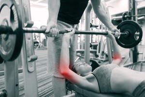 personal trainer working with sports injuries