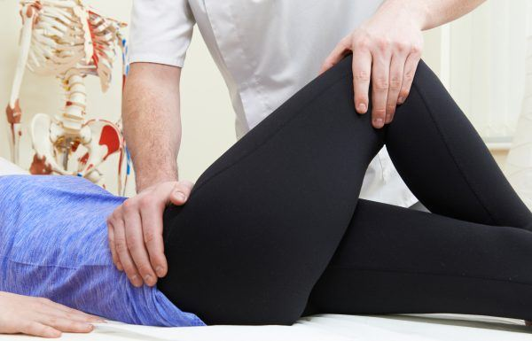 Chiropractor treating a hip injury