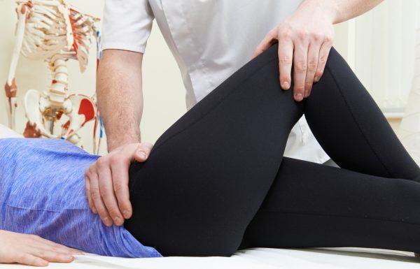 Chiropractor treating a hip injury