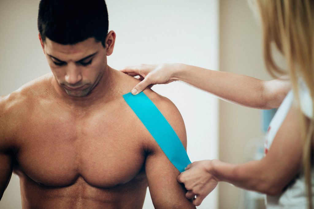 kinestiotaping for therapy and pain alleviation during exercise