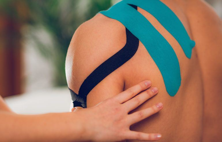 Shoulder treatment with kinesio tape