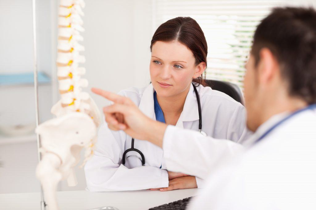 Chiropractor consulting on spine in Lincoln Park 60614